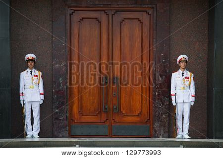HANOI, VIETNAM - JANUARY 10, 2016: Sentries of the honor guard at the door of the Ho Chi Minh mausoleum. The landmark of  Vietnam