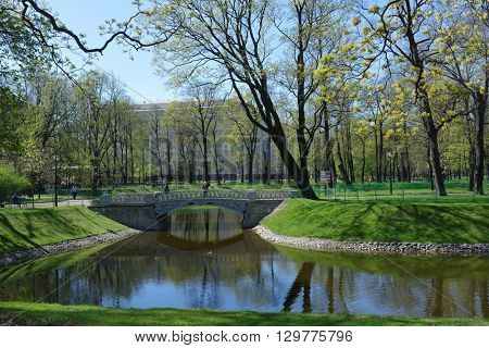 ST. PETERSBURG, RUSSIA - MAY 5, 2016: Pond and Mikhailovsky Palace in Mikhailovsky Garden in springtime. Built in 1819-1825 by design of Carlo Rossi, the palace houses the Russian Museum since 1895