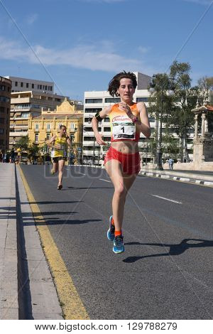 VALENCIA, SPAIN - MAY 15, 2016: Isabel Checa running the Volta a Peu Valencia Caixa Popular 8k run in the city of Valencia. Isabel won the women's division with a time of 28 minutes, 27 seconds.