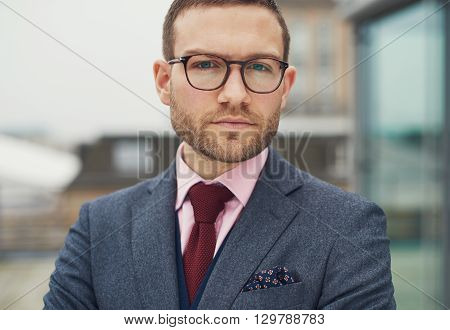 Thoughtful Businessman Staring At The Camera