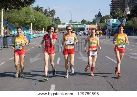 VALENCIA, SPAIN - MAY 15, 2016: Runners warming up before the Volta a Peu Valencia Caixa Popular 8k run. Isabel Checa, second from left, won the women's division with a time of 28 minutes, 27 seconds.