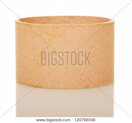 Empty cardboard tube isolated on white background.