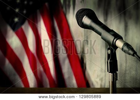 Old american flag and microphone. Microphone beside aged flag. Hear the sounds of past. Journey into the old times.