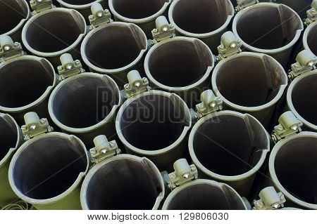 Jet missile launcher barrels abstraction, military industry, heavy mobile flamethrower system, green thermobaric ballistic weapon complex, modern army, selective focus