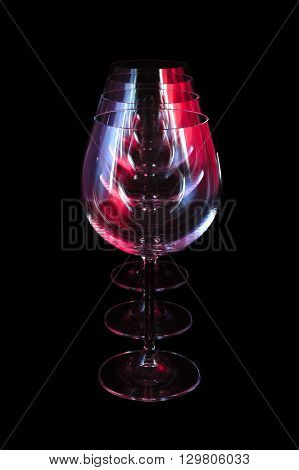 Party wine glasses in nightclub lit by red, blue, lilac lights, nightlife and entertainment industry, objects in row isolated on black background poster