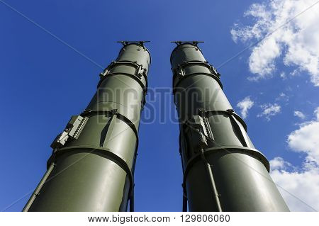 Antiaircraft missile complex, military ballistic launcher with two big missiles ready to attack with blue sky and white clouds on background, modern army industry
