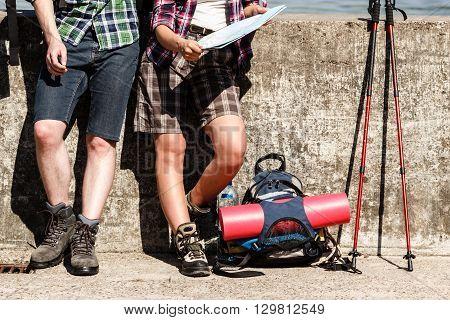 Hiking Couple Resting On Coast.