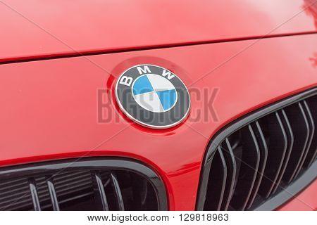 Red Bmw Logo On Detail