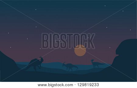 Silhoette of parasaurolophus at night with star and moon