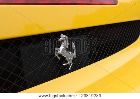 Yellow Ferrari Logo On Detail