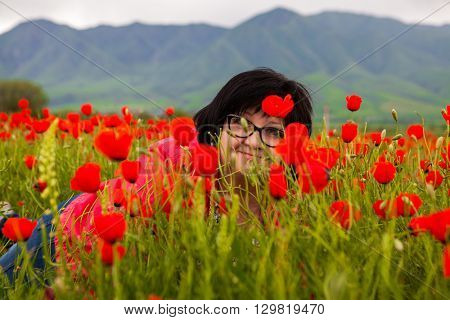 Portrait of a woman in a field of poppies