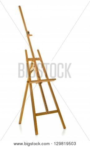 Unused brown wooden easel over white background