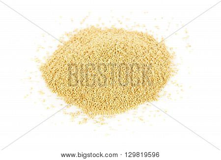 Heap of raw uncooked amaranth seeds over white background