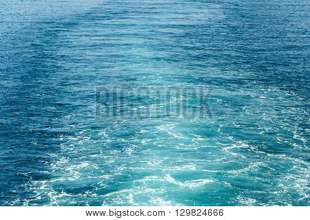 Blue water of the sea after ferry. Background texture