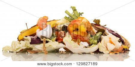 A pile of rotting food waste is isolated on a white background.
