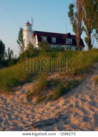 sunset at point betsie lighthouse on lake michigan near frankfort michigan. poster