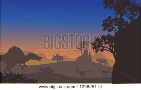 Silhouette of eoraptor and spinosaurus at the afternooon