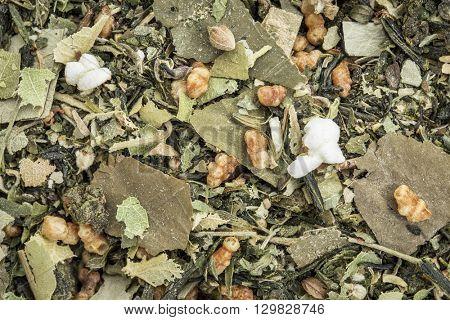 weight loss and detox herbal tea with oolong tea, lotus leaf, rice tea, green tea, Buddha tea,lemon balm and balsam pear - closeup background