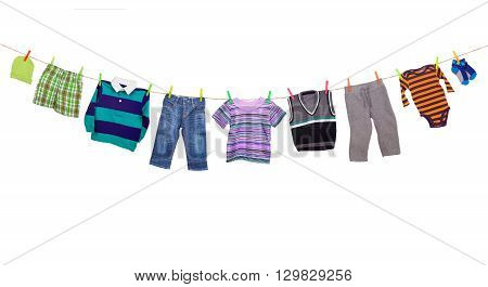 Laundry line with clothes on a white background