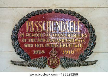 Dunedin New Zealand - November 16 2014: The Passchendaele memorial plate at Dunedin railway station New Zealand. The plate commemorates 56 members of the Dunedin section of New Zealand Railways (NZR) who lost their lives during the First World War.