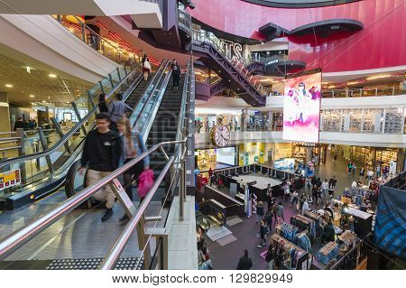 Melbourne, Australia - May 15, 2016: People visiting Melbourne Central, which is a complex with shopping mall, office tower and railway station. It is a popular tourist attraction in Melbourne, Australia.