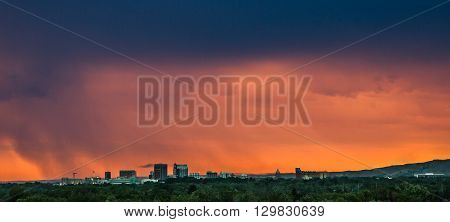 Town in the USA during a light storm at sunset