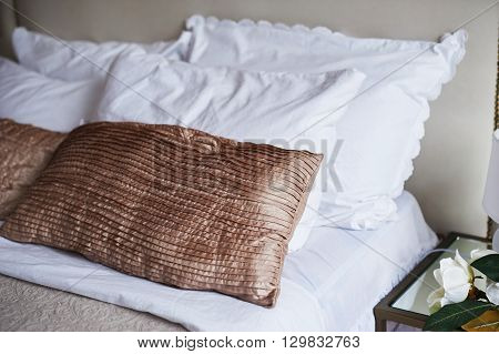 Colorful Pillow on hotel bed with space for text.