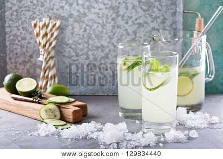 Basil lime and cucumber cooler in pitcher and tall glasses
