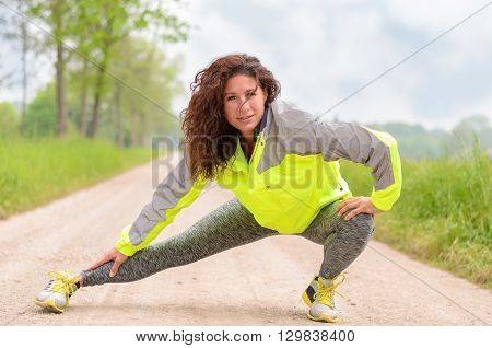 Sporty Young Woman Doing Stretching Exercises