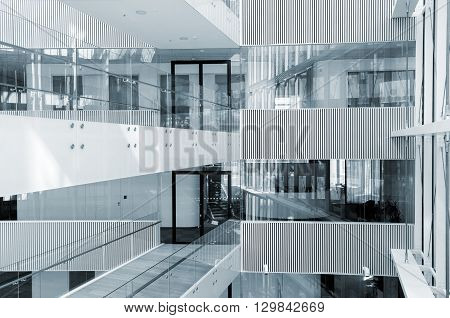 Blue colorized picture of abstract looking interior of modern business centre