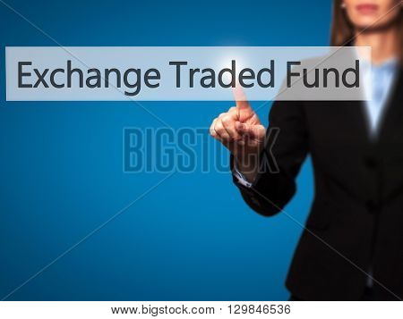 Exchange Traded Fund - Businesswoman Hand Pressing Button On Touch Screen Interface.
