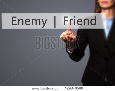 Enemy  Friend - Businesswoman Hand Pressing Button On Touch Screen Interface.