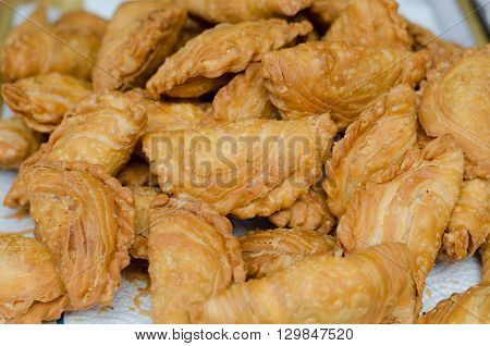 Curry Puffs (Epok-Epok / Karipap Pusing) - Deep Fried Malaysian Singaporean and Thai snack filled with curried meat and/or vegetables