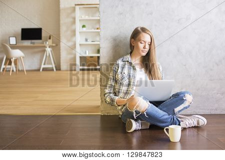 Girl Using Laptop In Interior