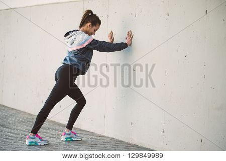 Hispanic Woman Stretching
