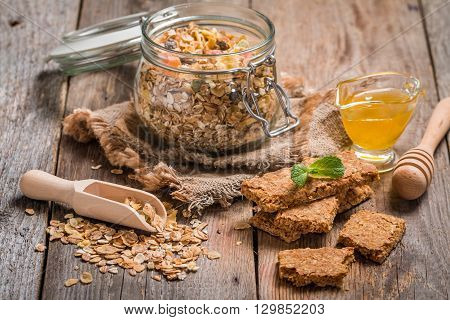 Granola bar from homemade granola with honey on wooden background