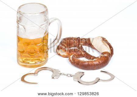 pretzel with handcuffs and beer mug over white