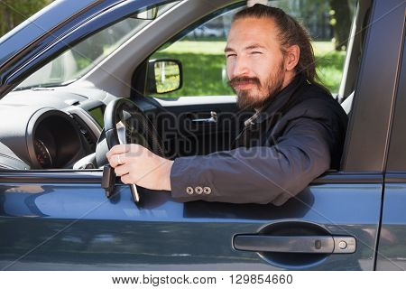 Bearded Man With Keys As A Driver Of Modern Suv