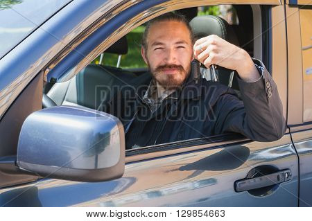 Smiling Man With Keys As A Driver Of Modern Car