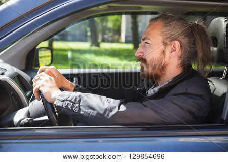 Asian Man As A Driver Of Modern Suv, Profile Portrait