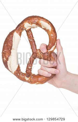 hand holding a pretzel over white background