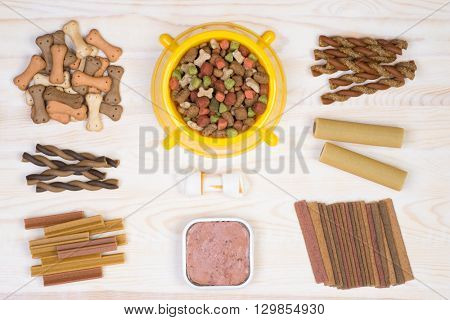 Dod food selection on white, wooden background, top view
