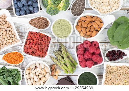 Healthy food called super foods on white, wooden background, top view