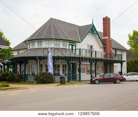 GANANOQUE CANADA - 18TH MAY 2015: The outside of the Heritage Museum in Gananoque during the day in the spring.