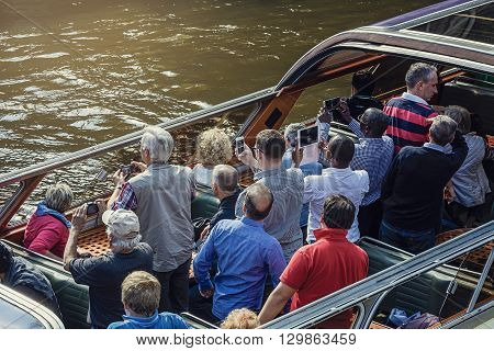 September 14 2014 Tourists in an open tour boat on the Prinsengracht canal in Amsterdam The Netherlands.