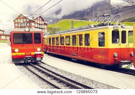 Kleine Scheidegg, Switzerland - July 09, 2012: Train to Kleine Scheidegg arrives from Jungfraujoch station.