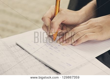 Young girl and education closeup of hands of student doing exercise for universitet exam.