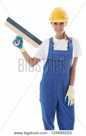 Young beautiful handywoman with masonry trowel isolated on white