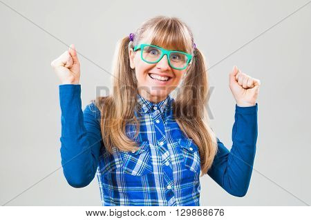 Studio shot portrait of cheerful nerdy woman