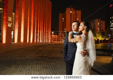 Gorgeous Newlyweds In City At Night
